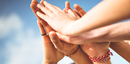 Adult and Kids Hands Together Blue Sky Thumbnail