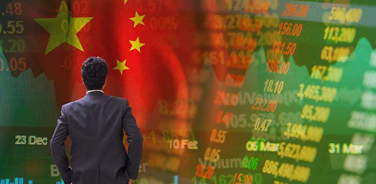 Business Man Looking at Stocks on China Flag Feature