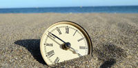 Clock on Beach Sand Thumbnail