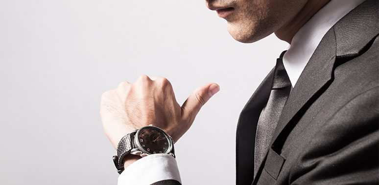 Man Looking At Watch Feature