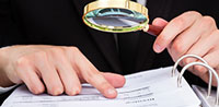 Man Using Magnifying Glass Thumbnail