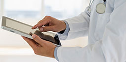 Medical Doctor Using Tablet Computer Thumbnail