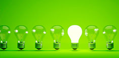 Six Lightbulbs Off One Bulb On Green Background Thumbnail
